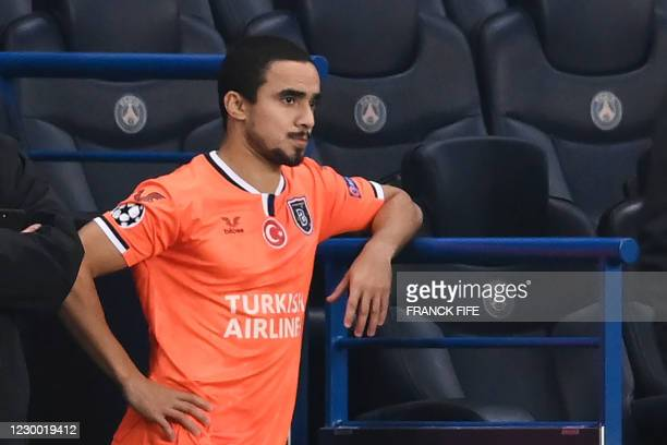 Istanbul Basaksehir's Brazilian defender Rafael looks on after the game was suspended amid allegations of racism by one of the match officials during...