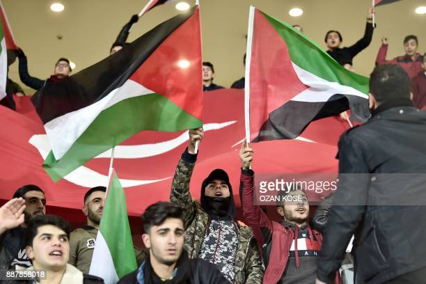 Istanbul Basaksehir's fans wave Palestinian flags during the UEFA Europa League football match Istanbul Basaksehir FK vs SC Braga at the Fatih Terim...