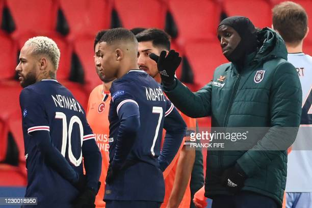 Istanbul Basaksehir's French forward Demba Ba gestures past Paris Saint-Germain's Brazilian forward Neymar and Paris Saint-Germain's French forward...