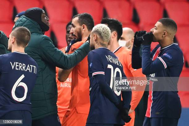 Istanbul Basaksehir's French forward Demba Ba gestures past Paris Saint-Germain's French forward Kylian Mbappe and Paris Saint-Germain's Brazilian...
