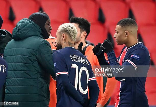 Istanbul Basaksehir's French forward Demba Ba speaks to Paris Saint-Germain's French forward Kylian Mbappe during the UEFA Champions League group H...