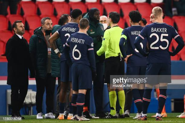 Istanbul Basaksehir's French forward Demba Ba talks to referee during the UEFA Champions League group H football match between Paris Saint-Germain...