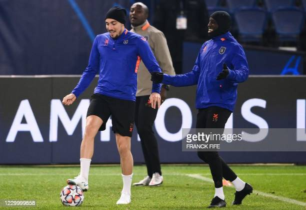 Istanbul Basaksehir's French forward Enzo Crivelli controls the ball next to Istanbul Basaksehir's French forward Demba Ba during a training session...