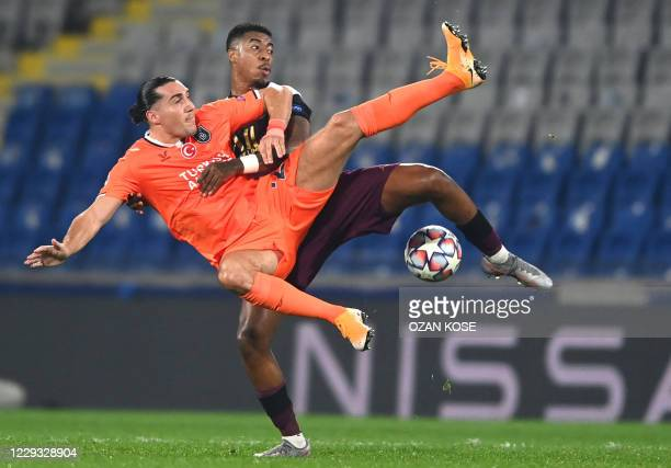 Istanbul Basaksehir's French forward Enzo Crivelli fights for the ball with Paris Saint-Germain's French defender Presnel Kimpembe during the UEFA...