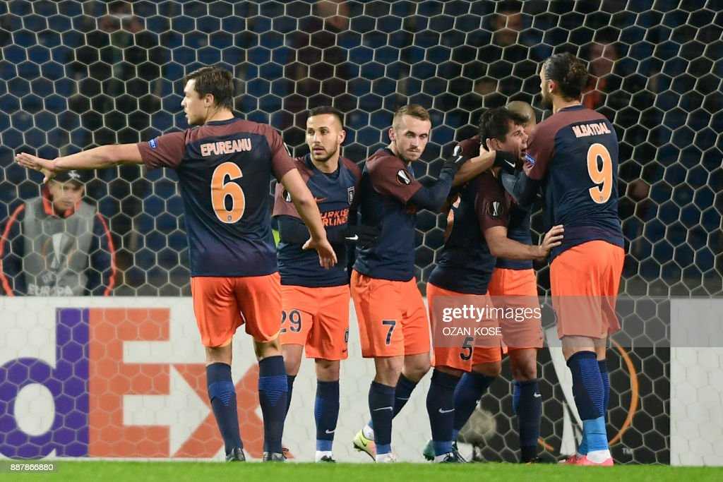 Istanbul Basaksehir's players celebrate after scoring during the UEFA Europa League football match Istanbul Basaksehir FK vs SC Braga at the Fatih Terim Stadium on December 7, 2017 in Istanbul. /