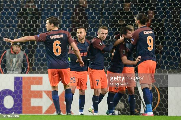 Istanbul Basaksehir's players celebrate after scoring during the UEFA Europa League football match Istanbul Basaksehir FK vs SC Braga at the Fatih...