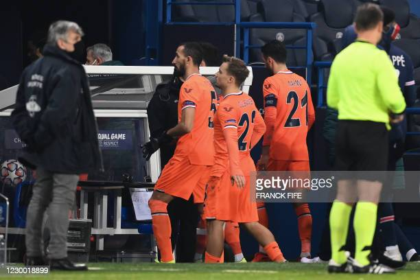 Istanbul Basaksehir's players leave the pitch after the game was suspended amid allegations of racism by one of the match officials during the UEFA...