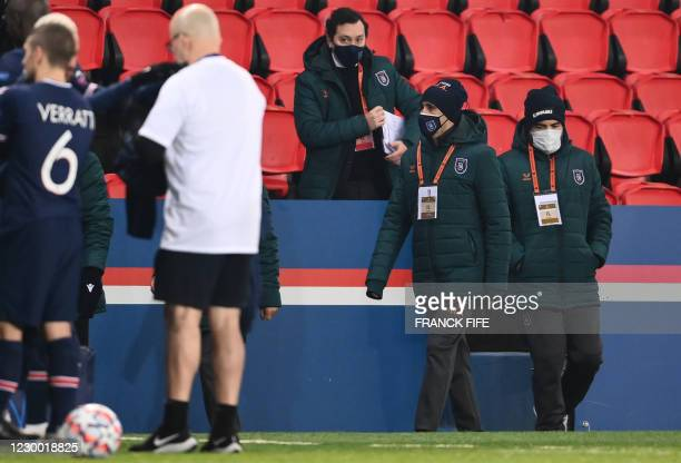 Istanbul Basaksehir's staff members leave the pitch after the game was suspended amid allegations of racism by one of the match officials during the...