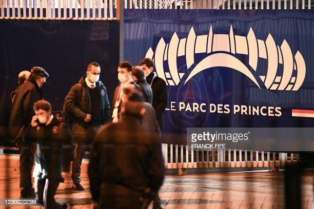 Istanbul Basaksehir's staff stand in front of a logo of the Parc des Princes stadium in Paris on December 8, 2020 after suspended UEFA Champions...