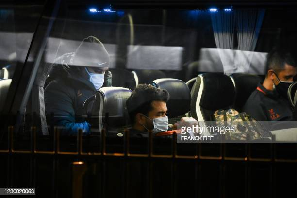 Istanbul Basaksehir's staff wait in a bus outisde the Parc des Princes stadium in Paris on December 8, 2020 after suspended UEFA Champions League...