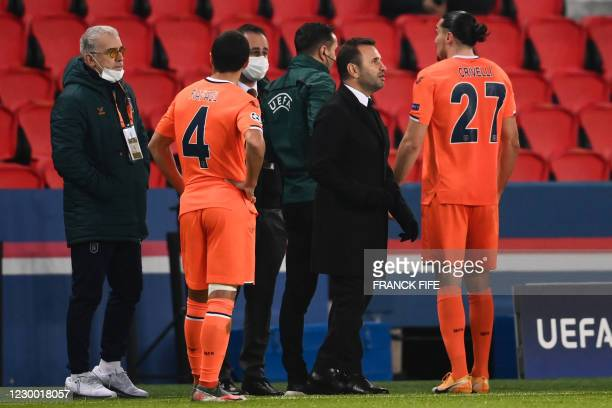 Istanbul Basaksehir's Turkish coach Okan Buruk looks on during the UEFA Champions League group H football match between Paris Saint-Germain and...