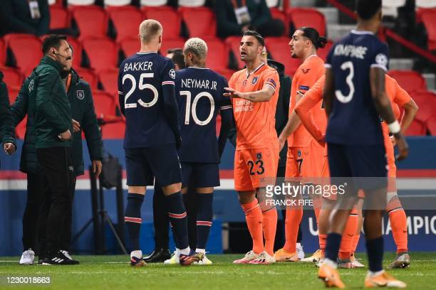 Istanbul Basaksehir's Turkish midfielder Deniz Turuc gestures as he speaks after the game was suspended amid allegations of racism by one of the...