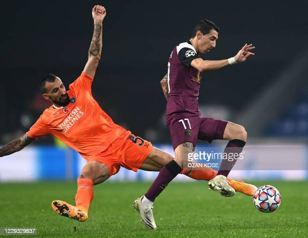 Istanbul Basaksehir's Turkish midfielder Mehmet Topal fights for the ball with Paris Saint-Germain's Argentine midfielder Angel Di Maria during the...