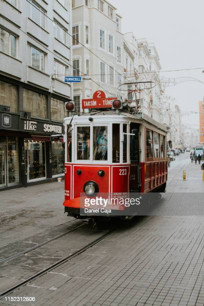 istanbul, city train on the taksim istiklal street - classical mythology character stock photos and pictures