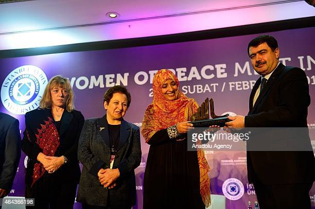 Istanbul Governor Vasip Sahin presents a gift to Nobel Peace Prize 2011 Winner Tawakkul Karman during the Peace in the Middle East conference under...