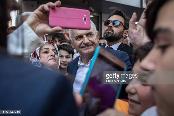 Istanbul mayoral candidate Binali Yildirim of the ruling Justice and Development Party meets with supporters during a campaign street stop on June 18...