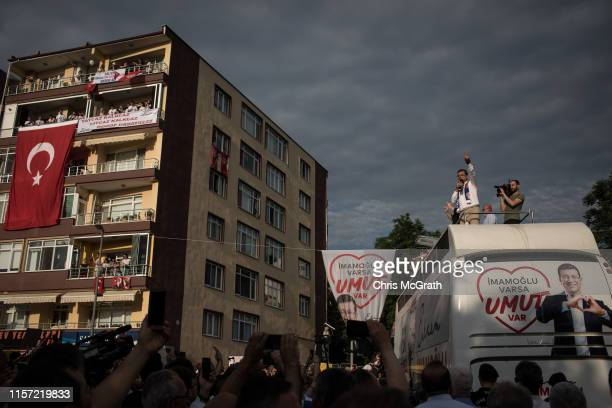 Istanbul mayoral candidate Ekrem Imamoglu of the Republican People's Party speaks to supporters from the roof of his campaign bus during a rally on...