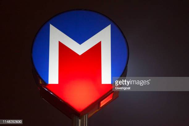 istanbul metro sign illuminated at night - gwengoat stock pictures, royalty-free photos & images