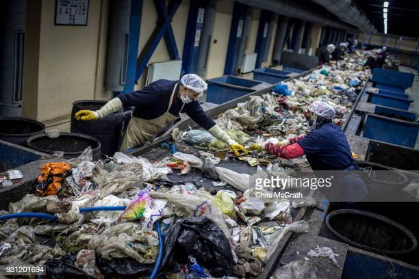 Istanbul Municipality waste facility employee's sort recycling waste at the Odayeri Recycling and Compost Waste Facility on March 12 2018 in Istanbul...