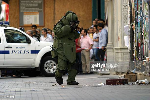 A forensic policeman examines a suspicious package that is left on the main street in central Istanbul 19 June 2007 A bomb exploded 15 June in the...