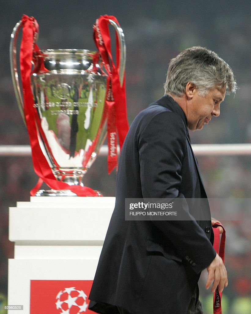 AC Milan's coach Carlo Ancelotti walks past the throphy at the end of the UEFA Champions league football final AC Milan vs Liverpool, 25 May 2005 at the Ataturk Stadium in Istanbul. Liverpool won 3-2 on penalties.