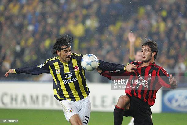 Alberto Gattuso of Milan vies for the ball with Servet Cetin of Fenerbahce at Sukru Saracoglu Stadium in Istanbul during their Champions League Group...