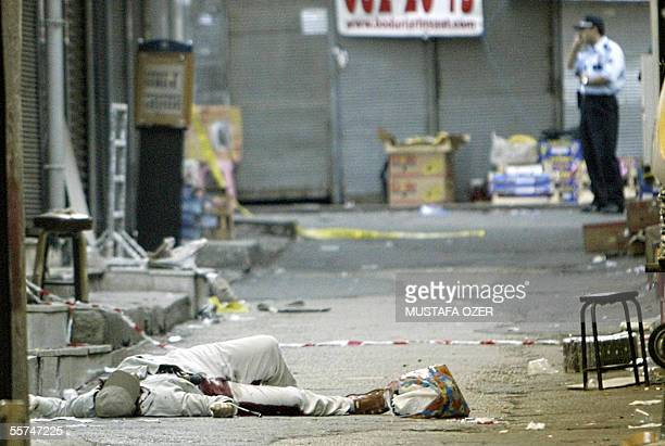 An unidendified bank robber lies in the street after being shot dead by Turkish Police as he was runing from a bank with a bag of money 23 September...