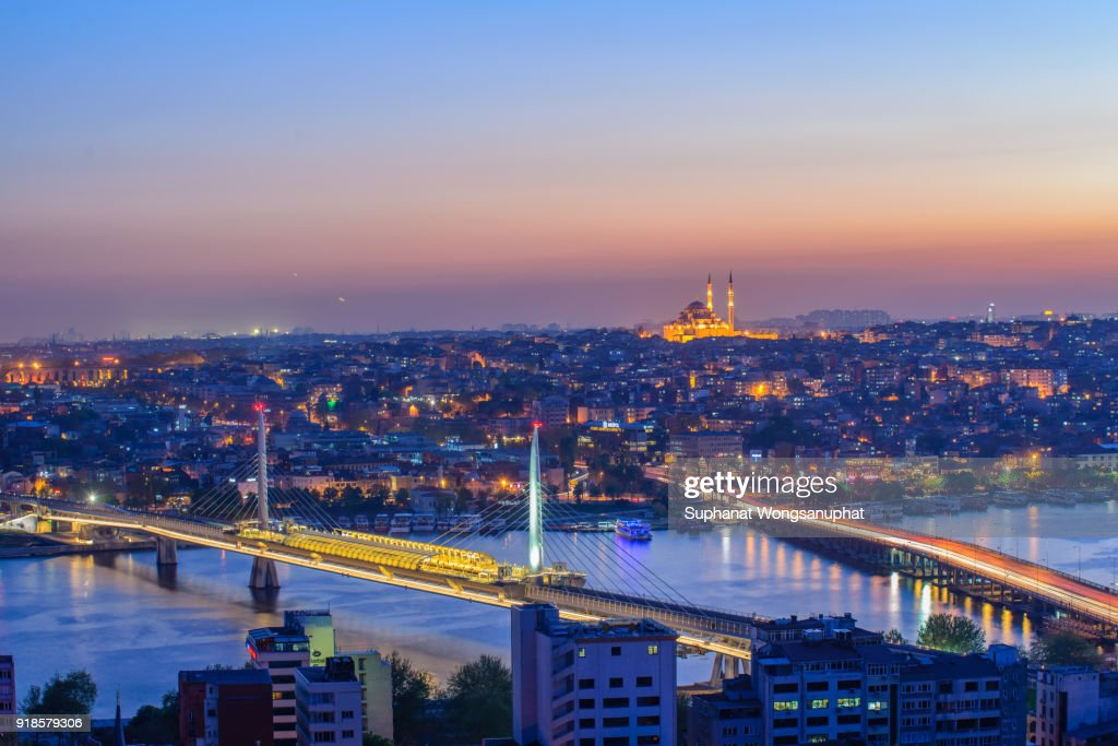 Istanbul Turkey capital city, mosque river and buildings purple and pink view skyline and skyscrapers in cityscape. : Stock Photo
