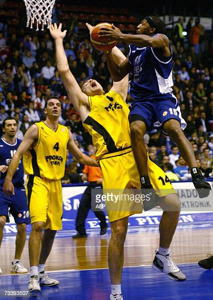 Efes Pilsen's Horace Jenkins tries to basket over Prokom Trefl Sopot's Michael Andersen during their Euroleague Top 16 Group F basketball match at...