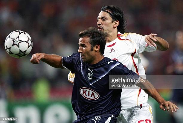 Galatasaray Istanbul's Hasan Kabze fights for the ball with Bordeaux's Marc Planus during their Champions League Group C match at Ataturk Stadium in...