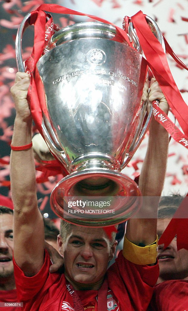 Liverpool's captain Steven Gerrard holds the throphy surrounded by teammates at the end of the UEFA Champions league football final AC Milan vs Liverpool, 25 May 2005 at the Ataturk Stadium in Istanbul. Liverpool won 3-2 on penalties.