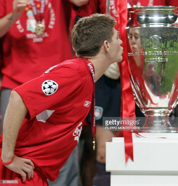 Liverpool's captain Steven Gerrard kisses the throphy surrounded by teammates at the end of the UEFA Champions league football final AC Milan vs...