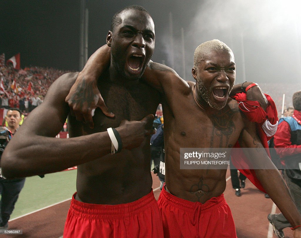 Liverpool's French defender Djimi Traore (R) and French striker Djibril Cisse (R) celebrate at the end of the UEFA Champions league football final AC Milan vs Liverpool, 25 May 2005 at the Ataturk Stadium in Istanbul. Liverpool won 3-2 on penalties.