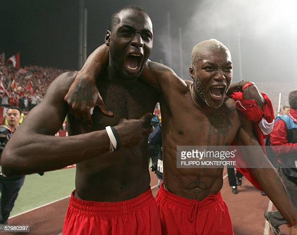 Liverpool's French defender Djimi Traore and French striker Djibril Cisse celebrate at the end of the UEFA Champions league football final AC Milan...