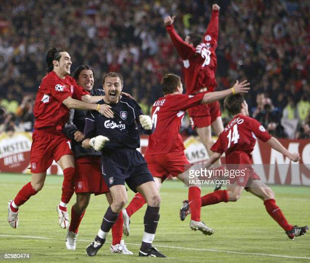 Liverpool's Polish goalkeeper Jerzy Dudek celebrates surrounded by teammates at the end of the UEFA Champions league football final AC Milan vs...