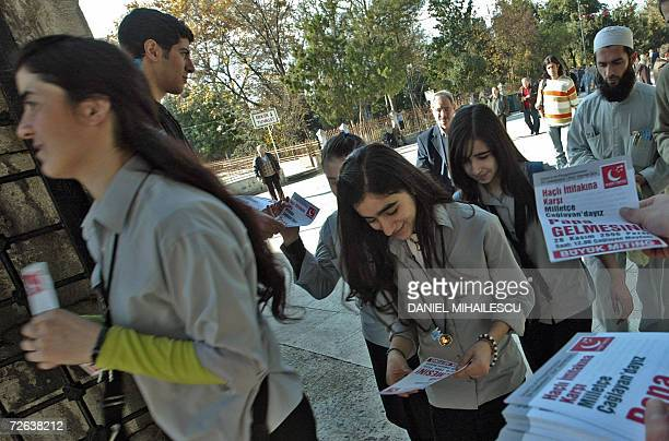 """Muslim activists hand out leaflets calling for a big demonstration 26 November 2006 and reading """"No to the Crusaders alliance! The ignorant and..."""
