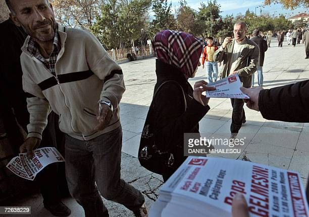 """Muslim activists hand out leaflets calling for a big demonstration on Sunday 26 November and reading """"No to the Crusaders alliance! The ignorant and..."""