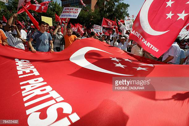 Supporters of Necmettin Erbakan leader of Saadet party attend an election rally in Istanbul 15 July 2007 Turkey holds parliamentary elections on 22...