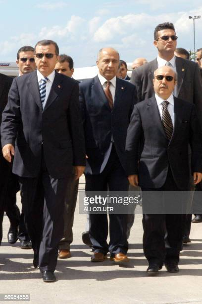 This picture taken in 2005 shows Turkish Minister of Finance Kemal Unakitan walking with Turkish Prime Minister Recep Tayyip Erdogan during a...