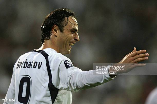 Tottenham's Dimitar Berbatov celebrates after his goal againist Besiktas during their UEFA Cup Group B soccer match at Inonu stadium in Istanbul 19...