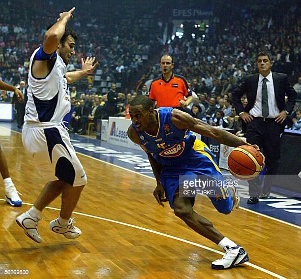 Willie Solomon of Maccabi Tel Aviv goes for a basket as Marko Popovic of Efs Pilsen tries to stop him 24 November 2005 during their Euroleague group...
