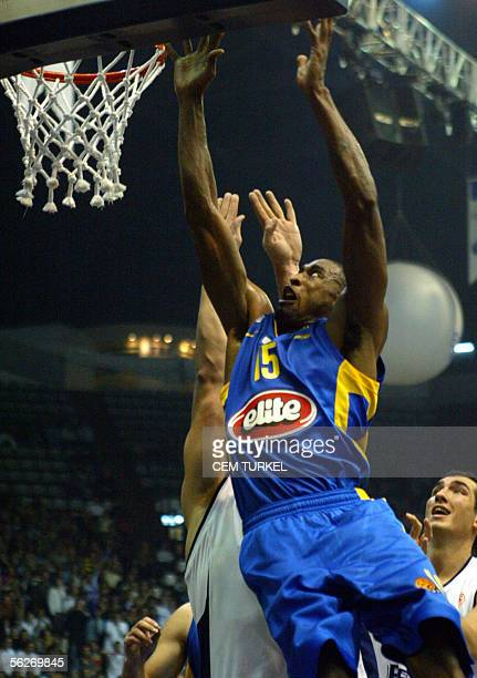 Willie Solomon of Maccabi Tel Aviv jumps for rebound with Nikola Prkacin and Kaya Peker of Efs Pilsen 24 November 2005 during their Euroleague group...