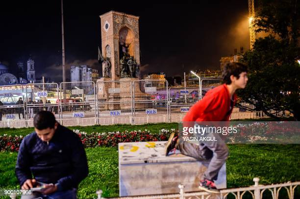Istanbul's main Taksim Square is secured by the police as people remember the victims of a deadly New Year's attack a year ago in Istanbul on...