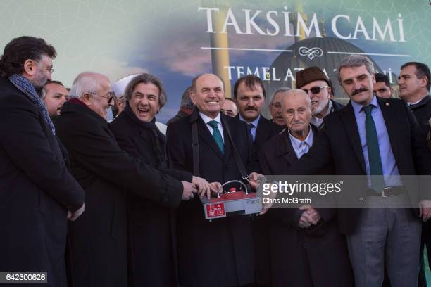 Istanbul's Mayor Kadir Topbas and other officials open the start of construction of the new controversial Taksim Mosque during a ground breaking...