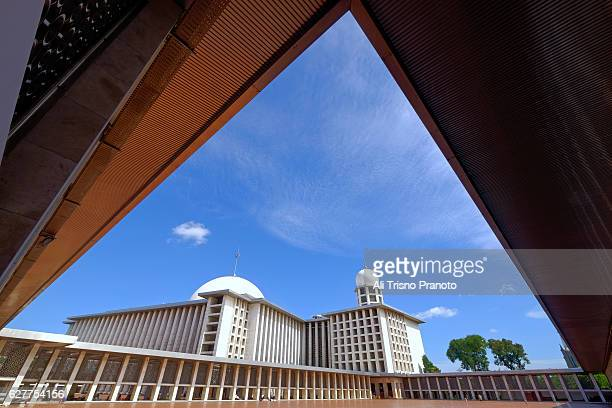 Istiqlal Mosque in fame with dramatic sky in Jakarta. Jakarta Landmark. Jakarta, Indonesia.