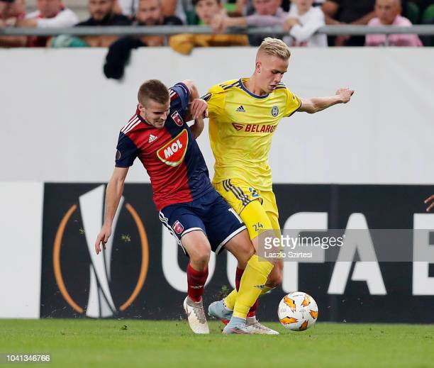 Istvan Kovacs of Vidi FC competes for the ball with Jasse Tuominen of FC BATE Borsiov during the UEFA Europa League Group Stage match between Vidi FC...