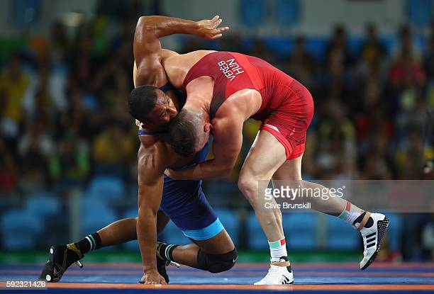Istvan Vereb of Hungary and Pedro Francisco Ceballos Fuentes of Venezuela compete during the Men's Freestyle 86kg Repechage on Day 15 of the Rio 2016...