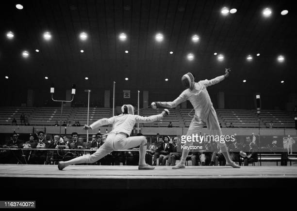 István Kausz of Hungary competes against Gianfranco Paolucci of Italy in the Men's Team Epee Fencing competition on 21st October 1964 during the...