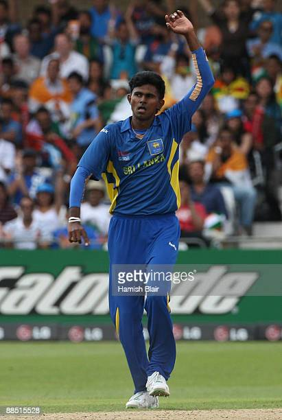 Isuru Udana of Sri Lanka celebrates bowling out Jacob Oram of New Zealand during the ICC World Twenty20 Super Eights match between New Zealand and...