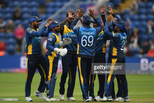 Isuru Udana of Sri Lanka celebrates taking the wicket of Rahmat Shah of Afghanistan with his teammates during the Group Stage match of the ICC...